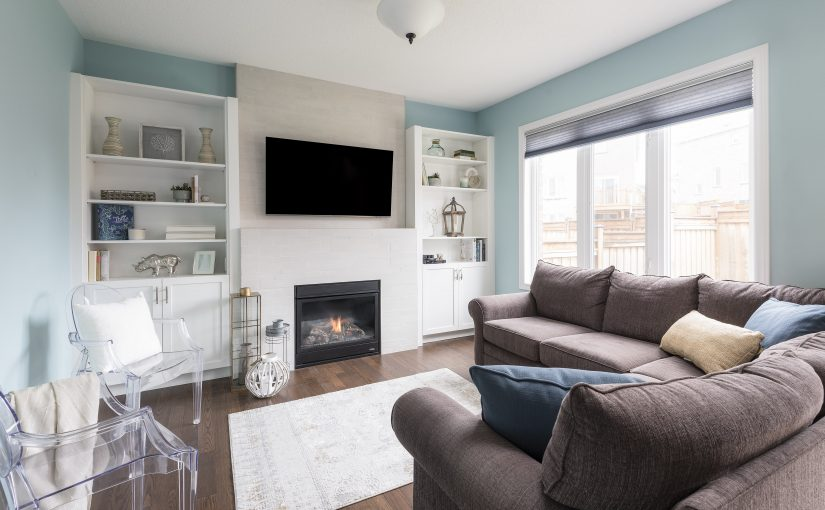 White Adds Warmth to this Family Room Fireplace Design